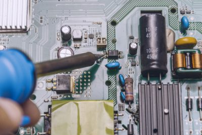 engineer-use-soldering-iron-repair-television-board_33715-472